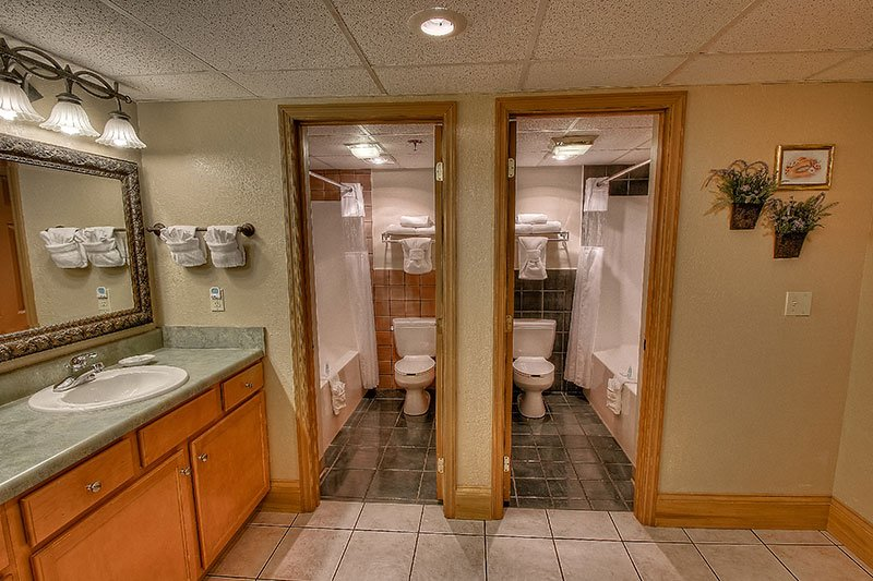 two bathrooms with vanity in family suite at Willow Brook Lodge